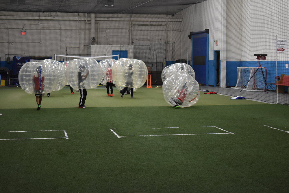 Kids having fun with bubble soccer
