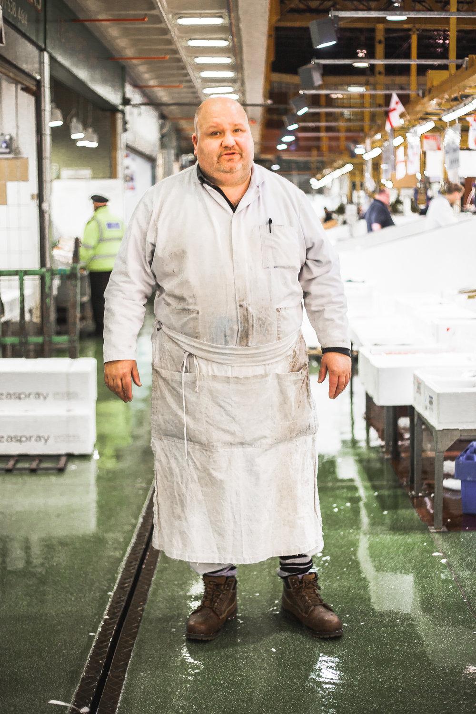 Fishmonger, Billingsgate market, London, 2016.