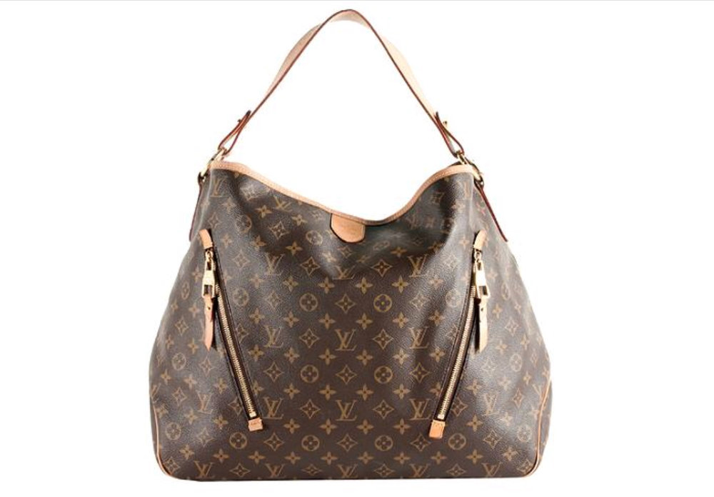 """For the past few years, I've been traveling with two carry-on bags. The first is my Louis Vuitton Delightful Tote, which was a gift and which I am convinced is both bulletproof and bottomless...if you travel often, I suggest investing in a bag with strong handles and a tough exterior. I have shoved this one under countless airplane seats and used it to tote my iPad and files around to meetings all over the world.  The second is my Coach Explorer Overnighter, which is endlessly stylish, timelessly cool, and easy to smush into an overhead airplane bin to avoid the dreaded """"gate check"""" when space runs low. What I love most about both my bags is that no matter how banged up or weathered they get, the high quality leather means they just become more beautiful and authentic. Just as my smile lines tell the story of my life, these great bags help tell the story of my travels."""