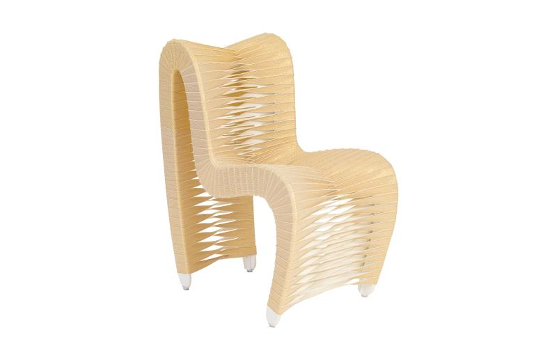 Seatbelt dining chair in gold.jpeg