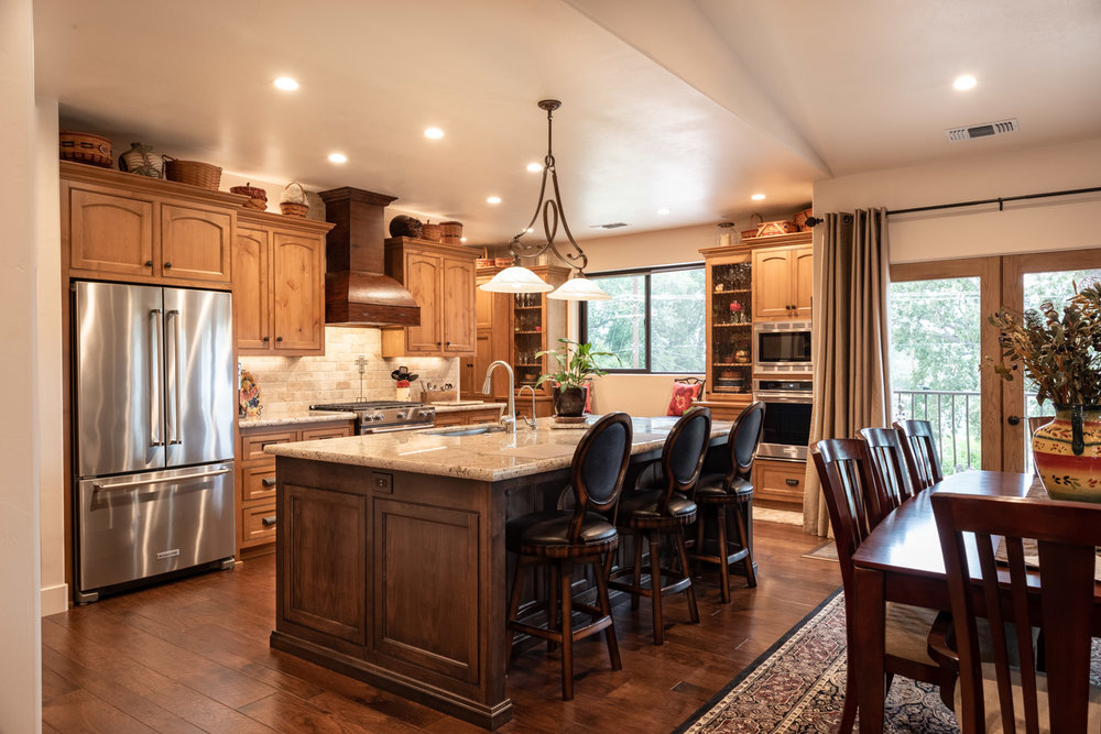 Tuscan Artisan kitchen with island and mixed stained wood cabinets