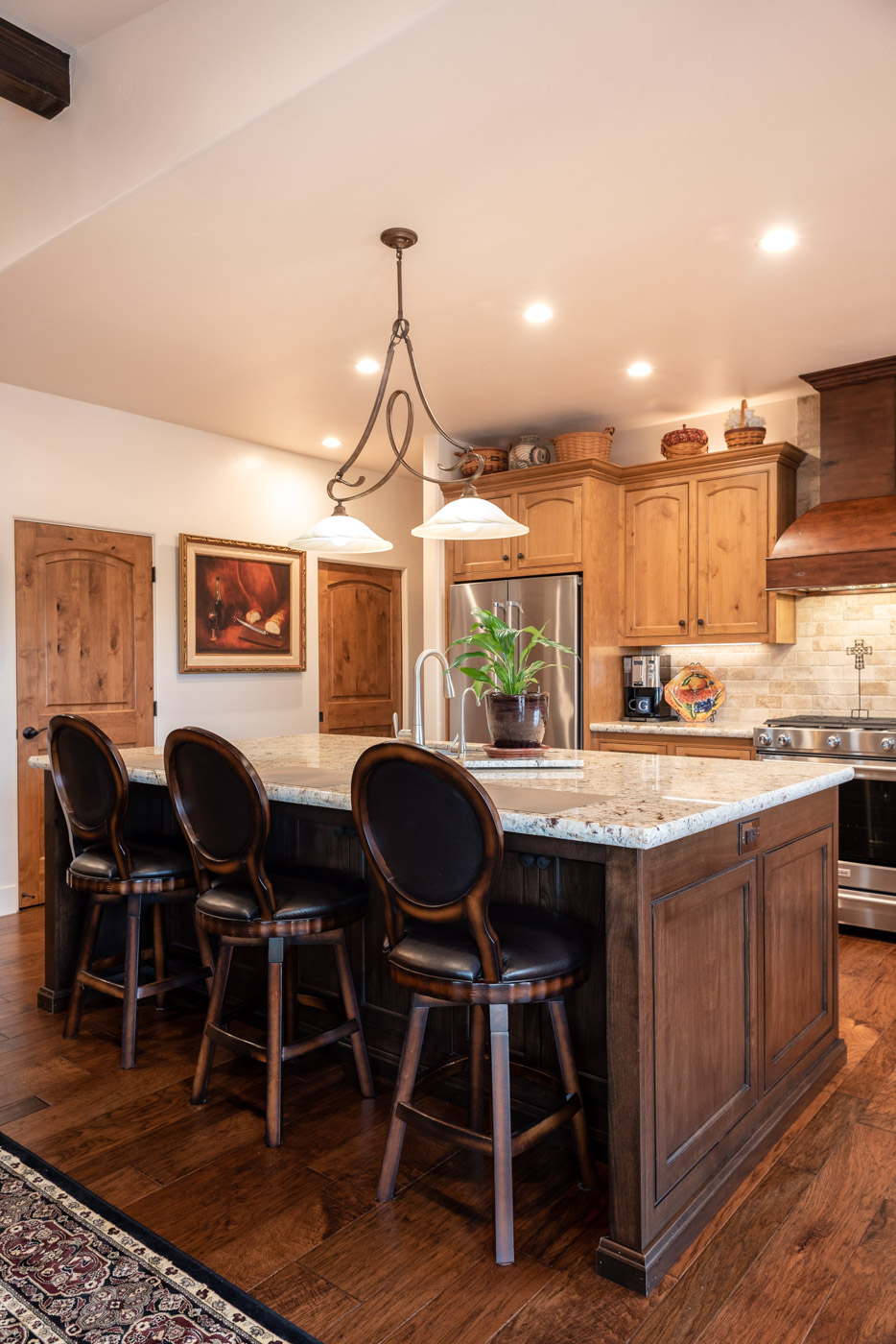 Tuscan Artisan custom stained Alder wood kitchen cabinets and island