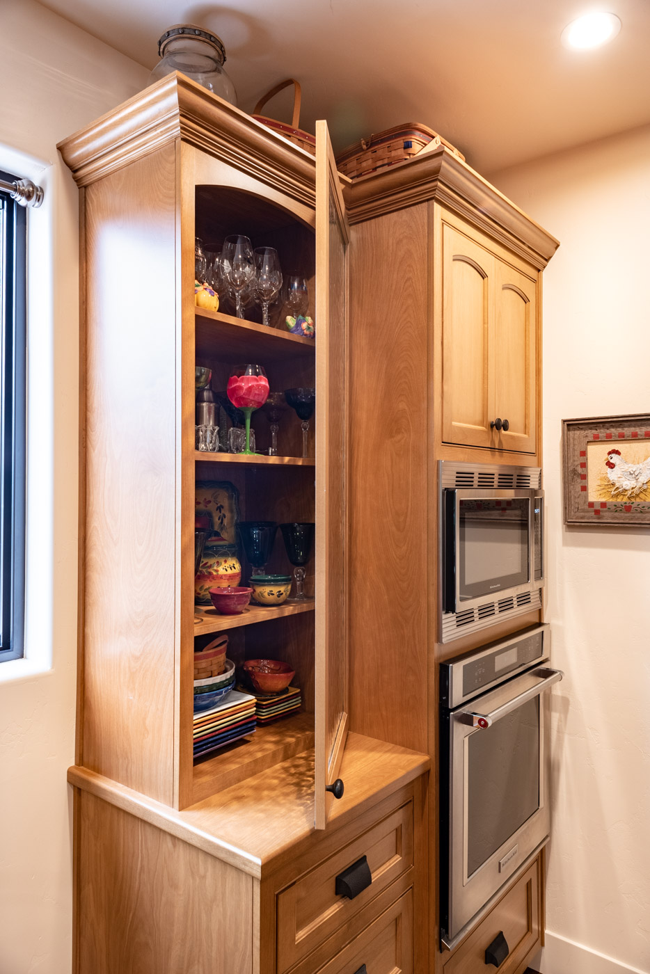 Tuscan Artisan custom stained Alder wood kitchen cabinet display