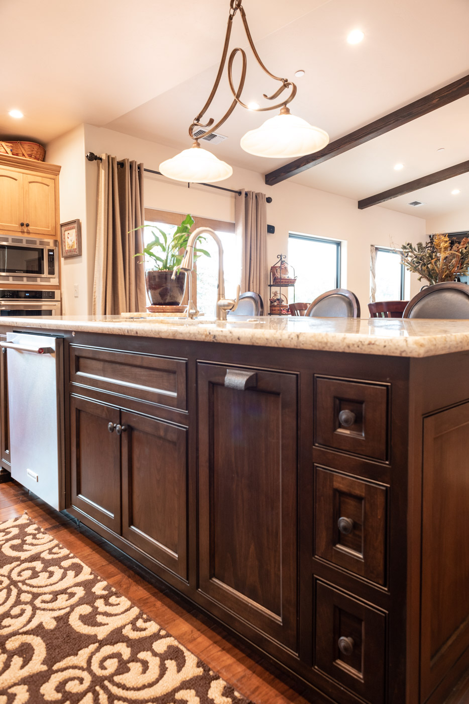 Tuscan Artisan custom stained Alder wood kitchen island