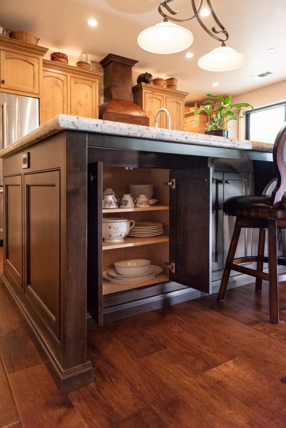 Tuscan Artisan custom stained Alder wood kitchen island storage