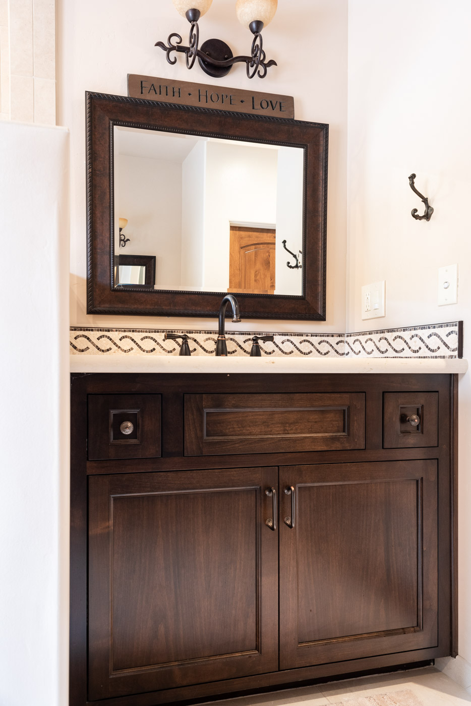 Tuscan Artisan custom stained Alder wood bathroom vanity cabinet