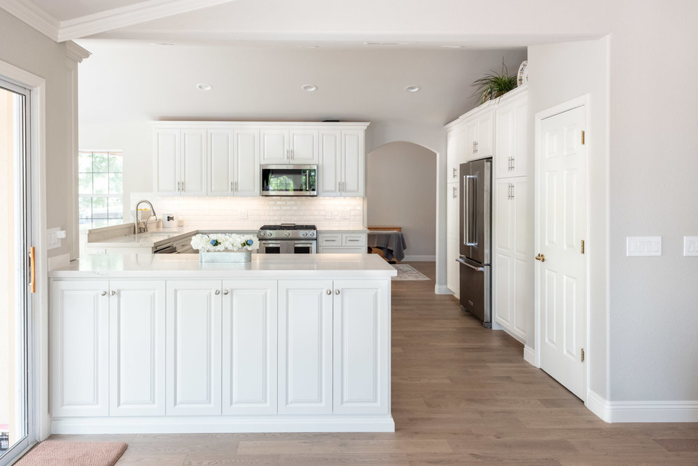 Modern Farmhouse Cottage kitchen with custom white painted cabinets