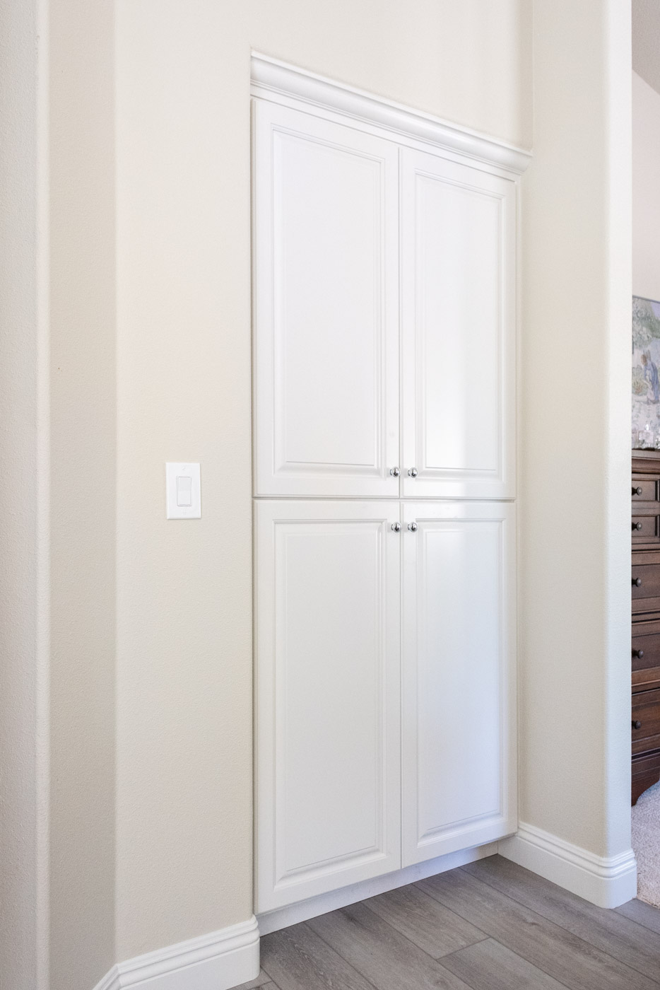 Modern Farmhouse Cottage bathroom linen closet with custom white painted cabinets