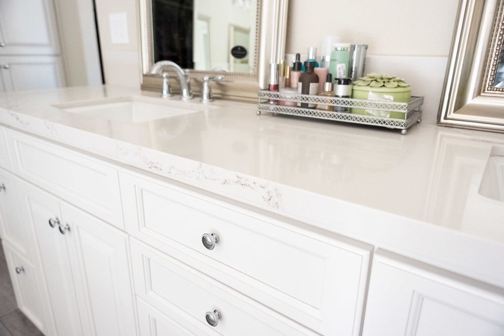 Modern Farmhouse Cottage bathroom vanity with custom white painted cabinets and marble counter tops
