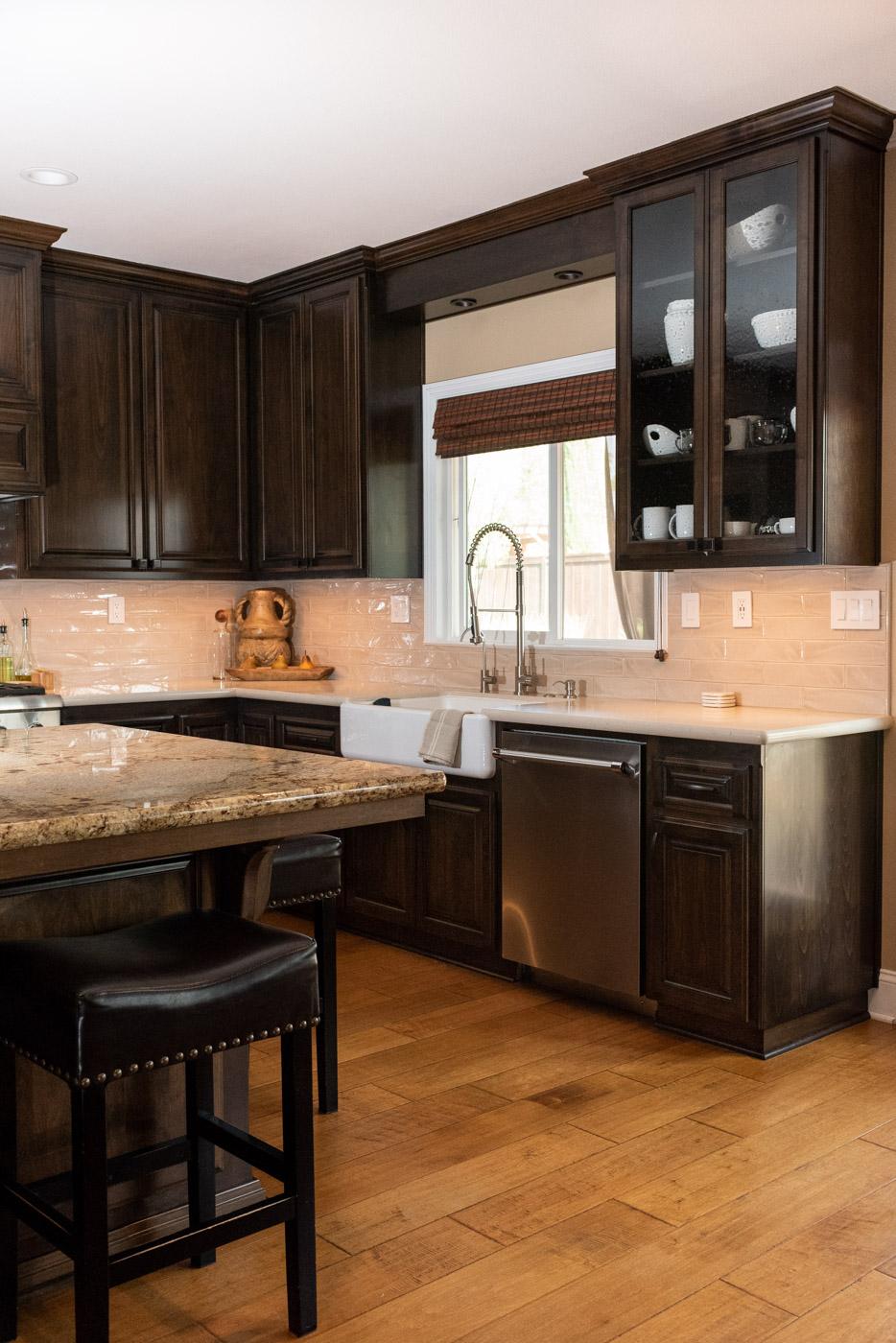 Traditional Mediterranean kitchen with dark wood stain cabinets