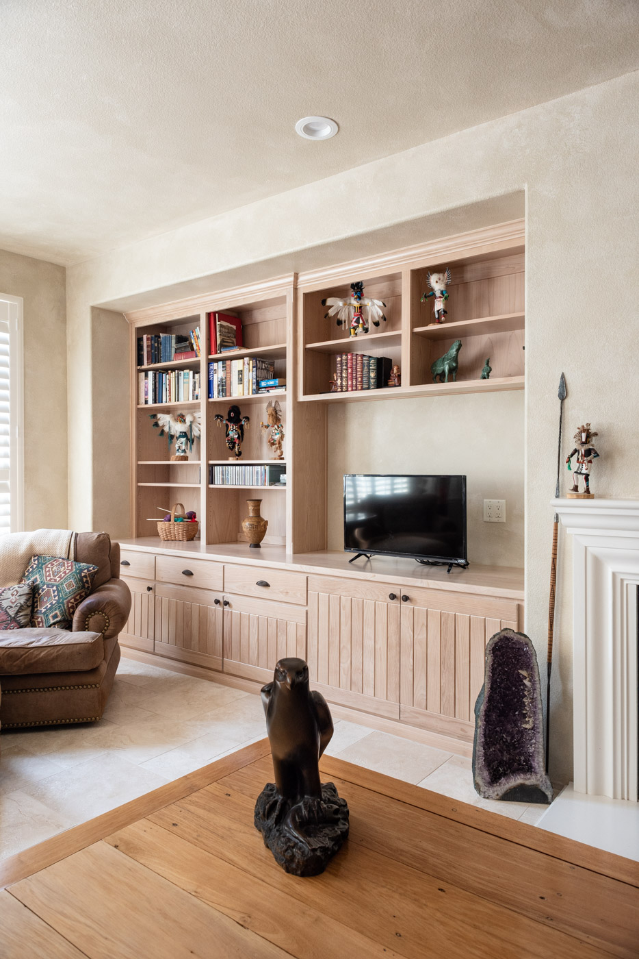 Simple Southwestern style home with custom living room built in bookcase cabinets