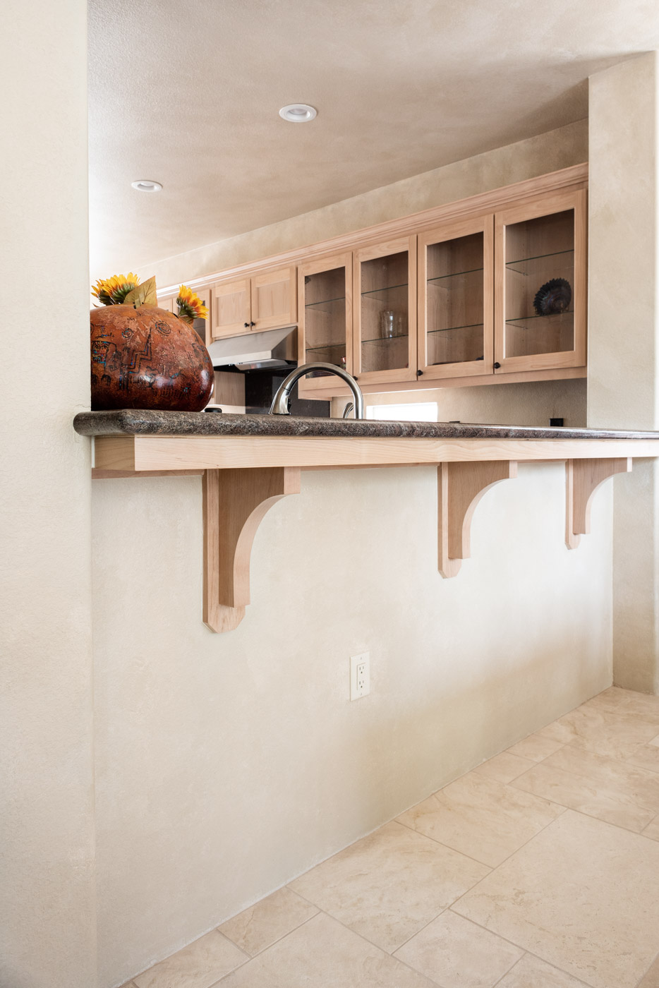 Simple Southwestern custom kitchen bar overhand in white washed wood stain