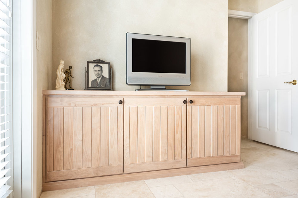Simple Southwestern custom home office cabinets in white washed wood stain