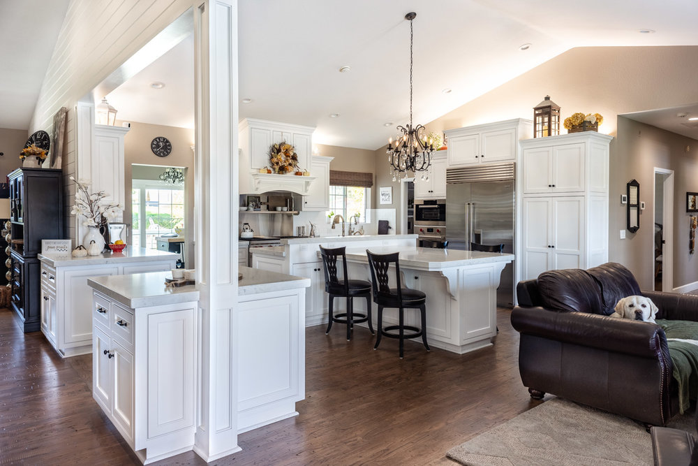 Transitional open-concept kitchen with white custom painted cabinets