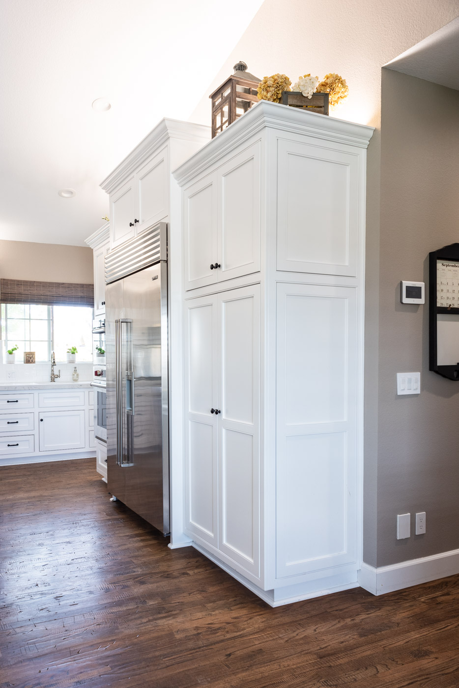 Transitional Country Cottage style kitchen with white recessed panel painted cabinets