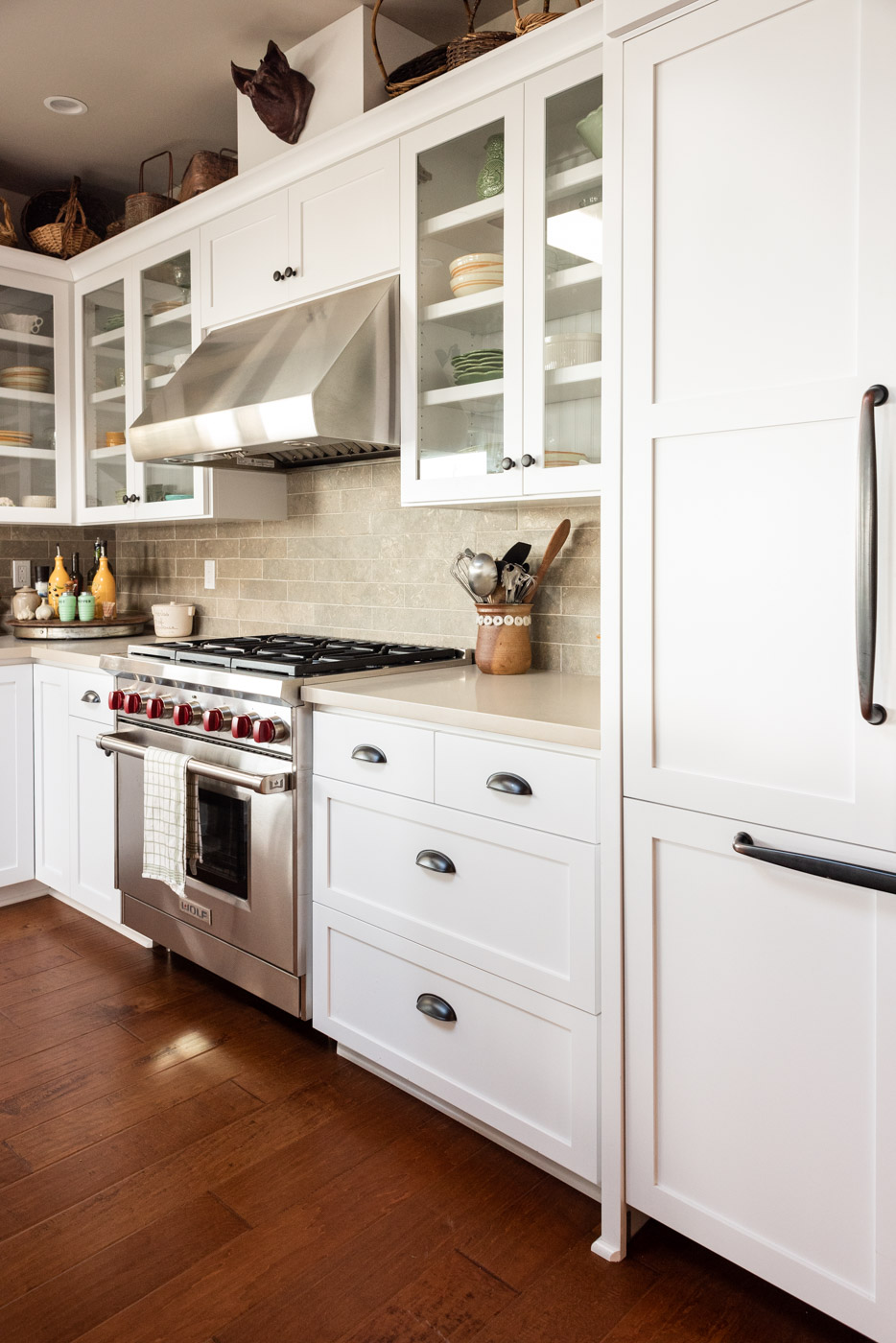 Coastal Craftsman kitchen with custom white painted shaker cabinets