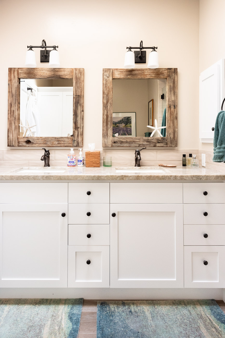 Coastal Craftsman home with custom white painted bathroom vanity cabinets