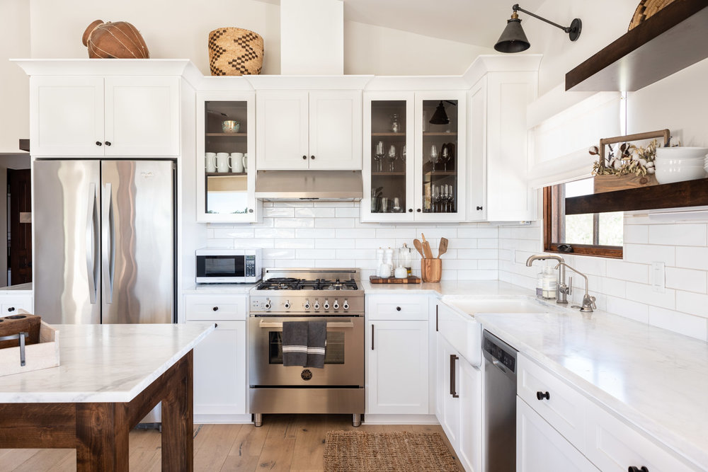 Vineyard Guest House kitchen with custom white painted shaker cabinets and open shelving