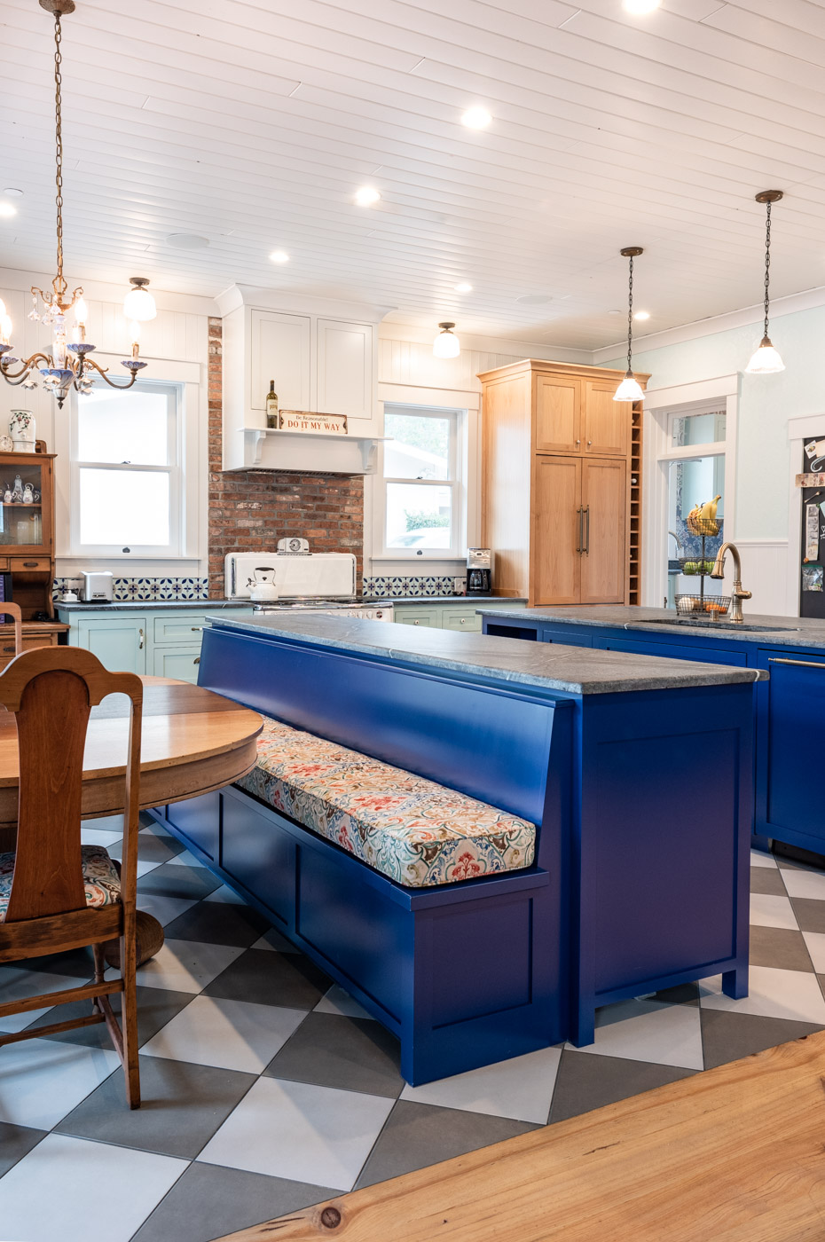 Eclectic Country Craftsman kitchen with custom blue painted cabinets and built in bench seating