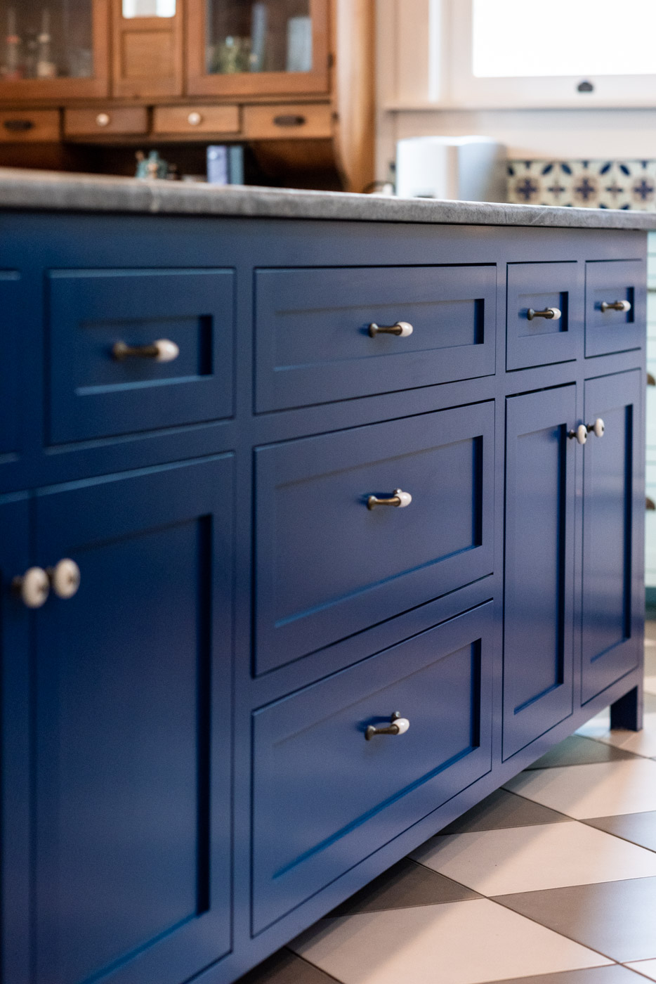 Eclectic Country Craftsman kitchen with custom blue painted cabinets and island storage