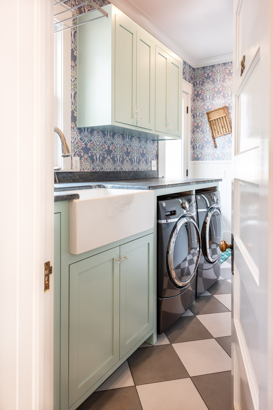 Eclectic Country Craftsman laundry room with custom blue painted cabinets and farmhouse sink