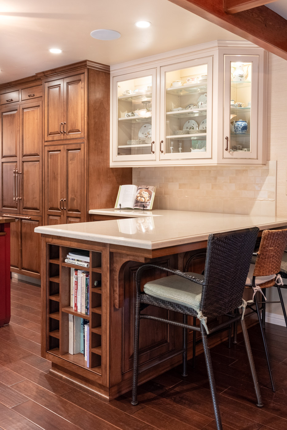 English Country custom kitchen cabinets with peninsula wine rack and open shelves