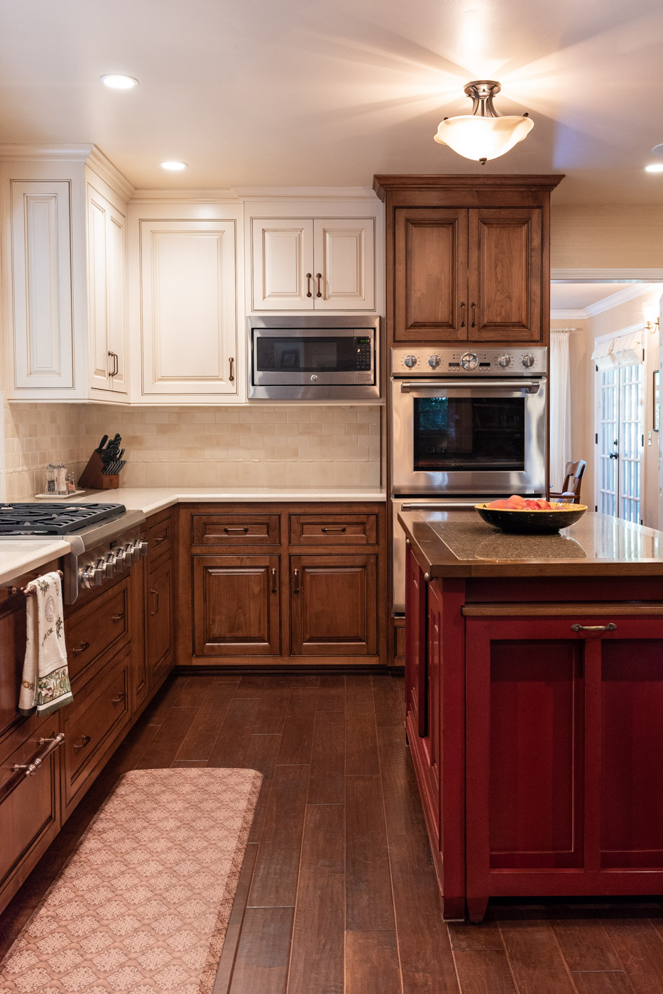 English Country custom kitchen cabinets with mixed finishes and red cabinet paint island