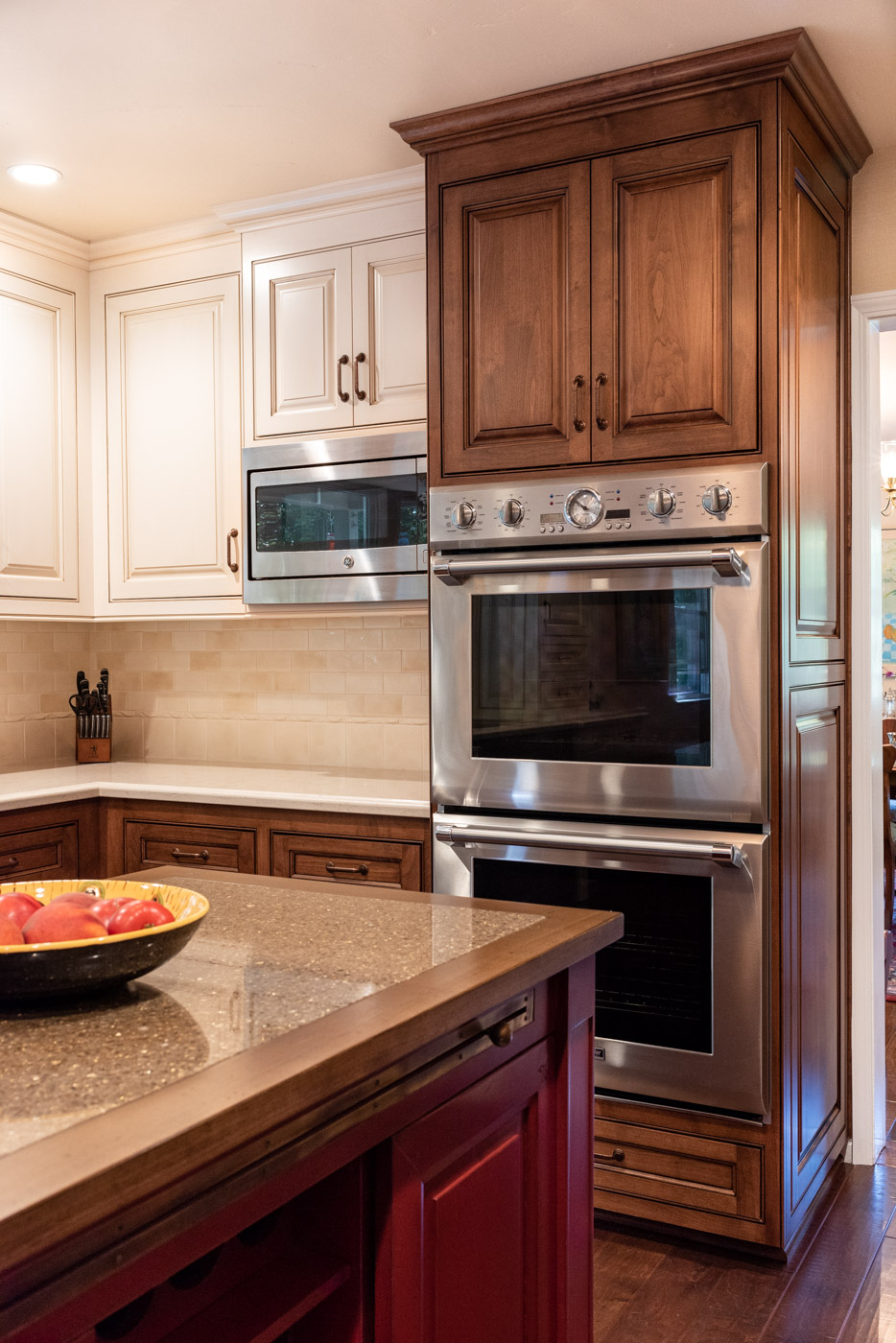 English Country custom kitchen cabinets with double ovens
