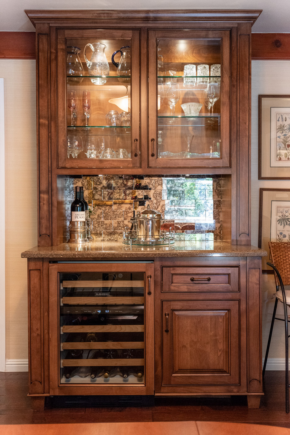 English Country custom home bar with glass display cabinets and wine fridge