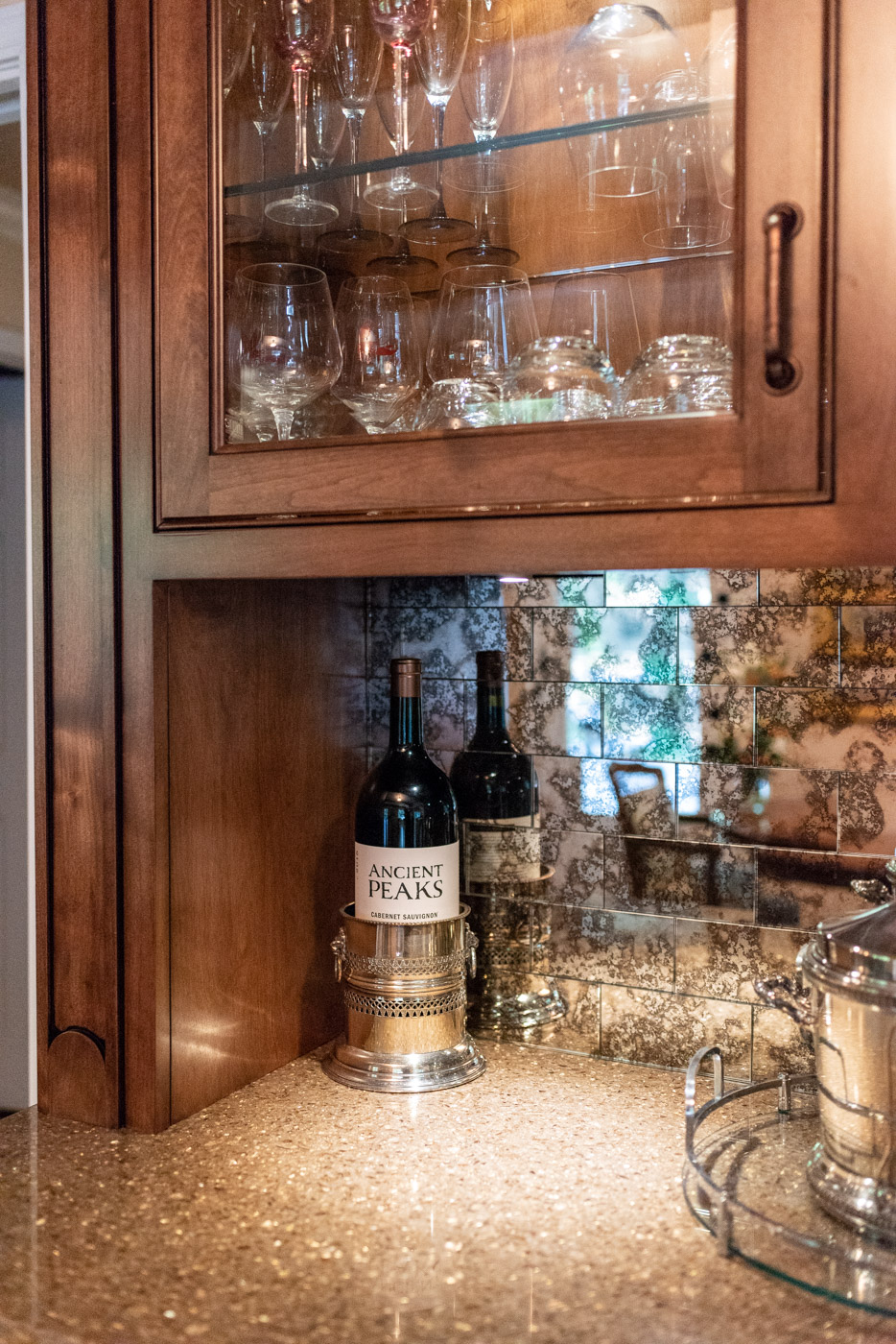 English Country custom home bar with glass display cabinets and quartz countertop