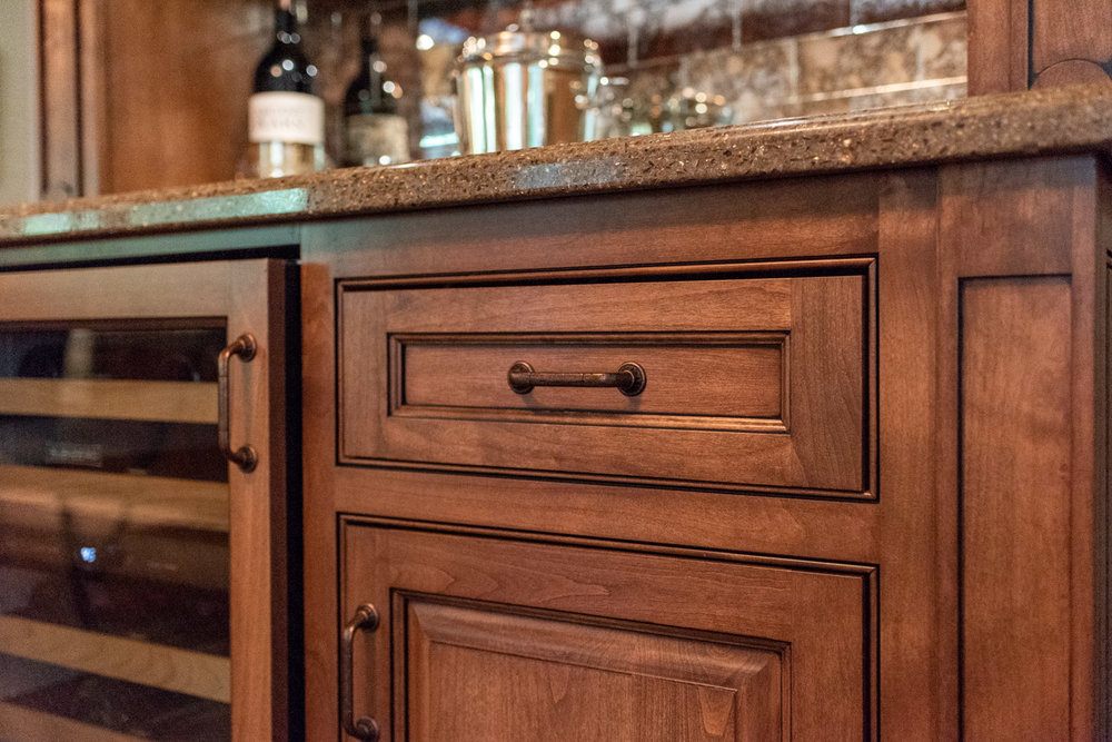 English Country custom home bar with small bone flush inset cabinet doors