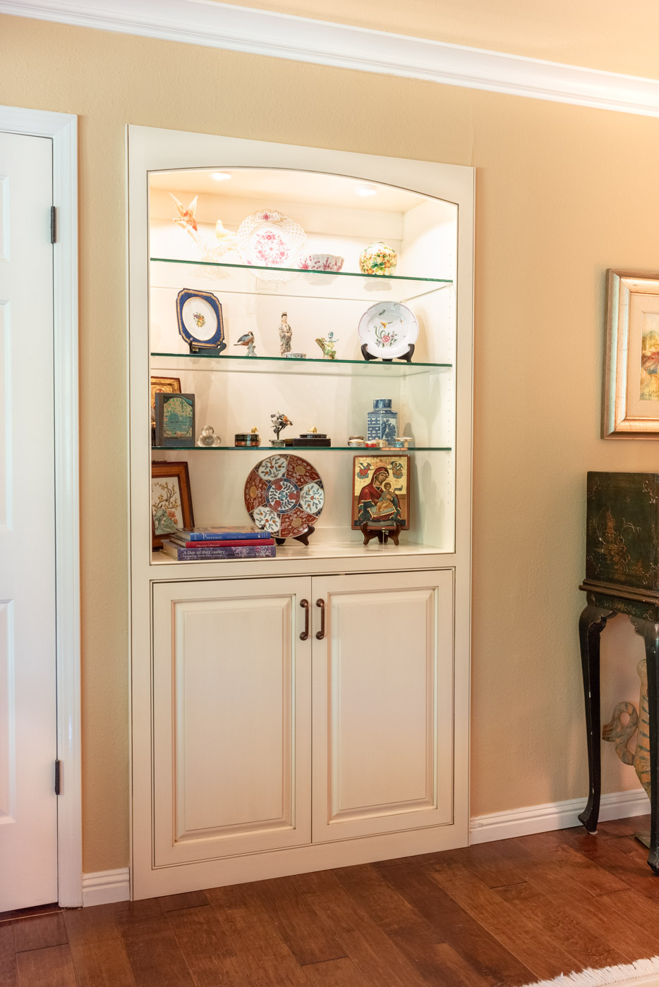 English Country Home custom living room built-in cabinet with glass display shelves