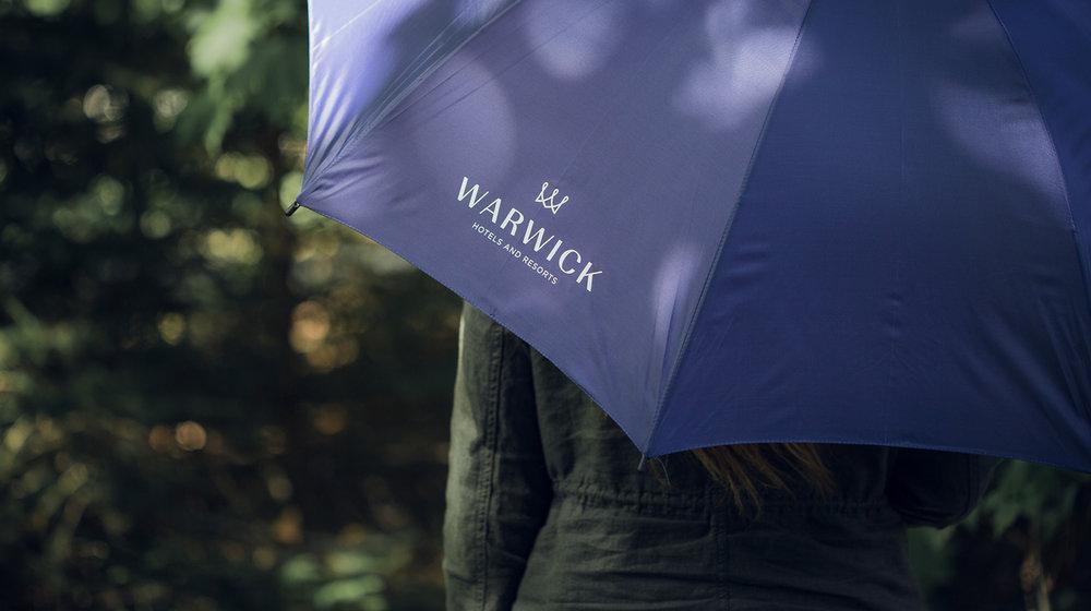 Warwick Hotels umbrella touchpoint design