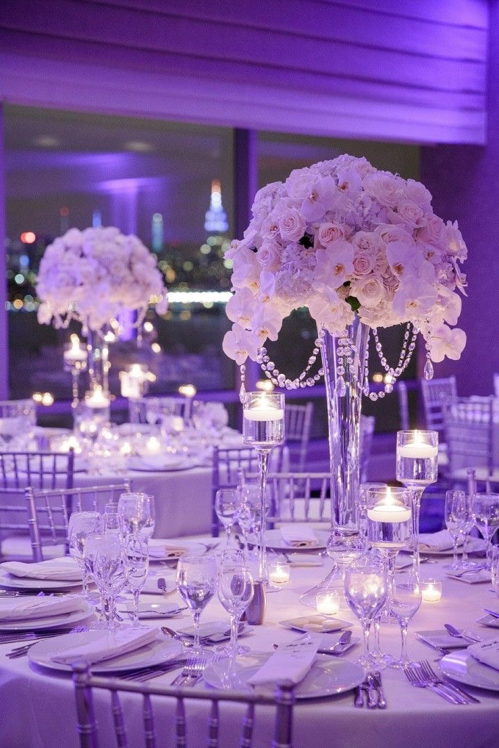 White & Clear Table Decor with Purple Uplighting