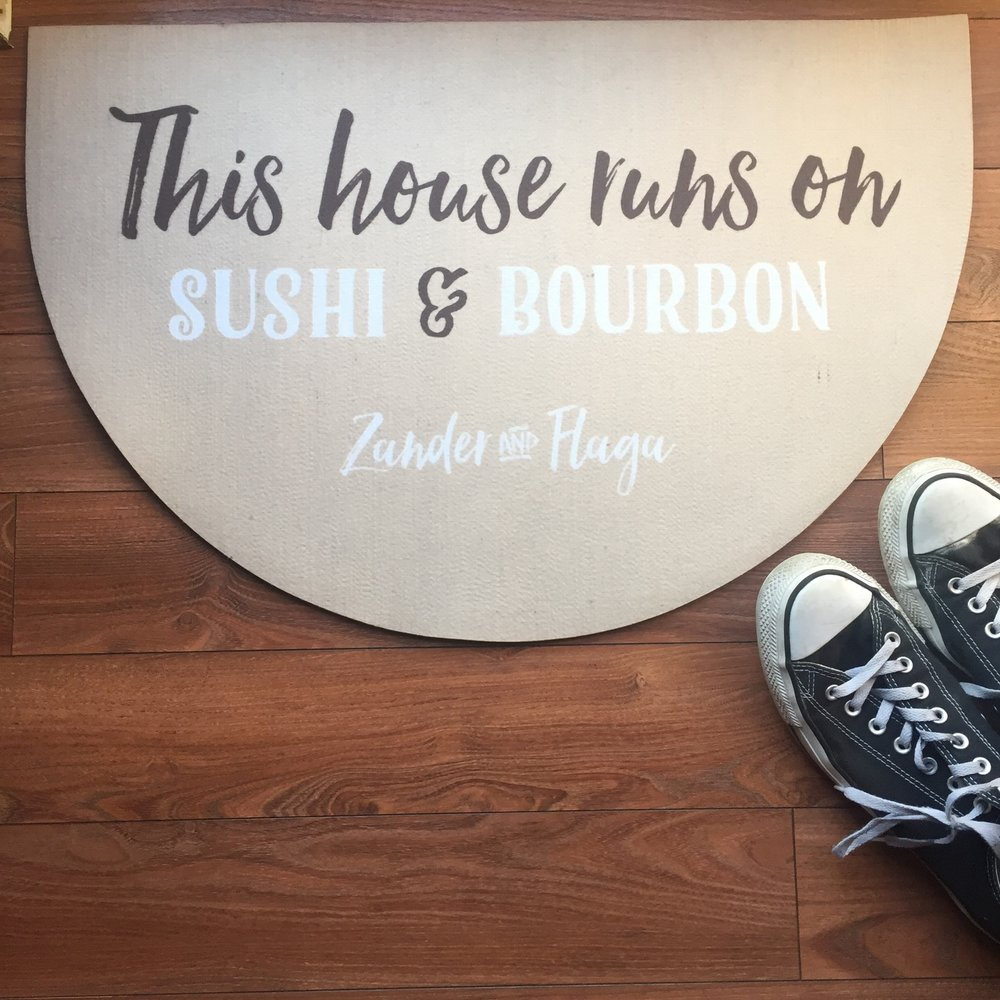 This house runs on Sushi & Bourbon doormat