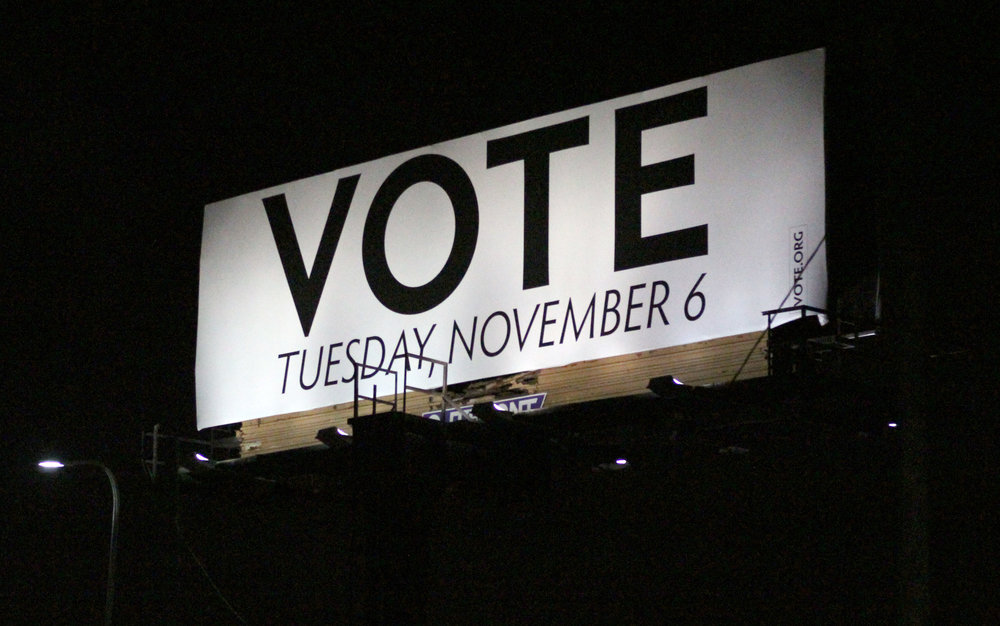 The night of Tuesday, November 6th, off of 8 Mile rd. in Ferndale, 11 p.m. after the polls closed, a billboard illuminates the sky, reminding citizens to vote.