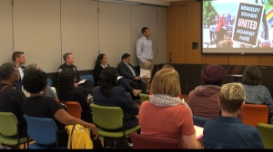 Attendees listen to presenters announce UAH Week in Berkeley, CA