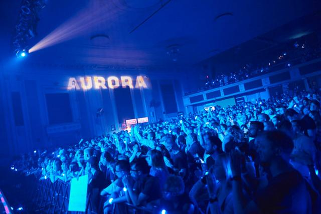 Aurora cannabis logo projected on wall during concert in Toronto.