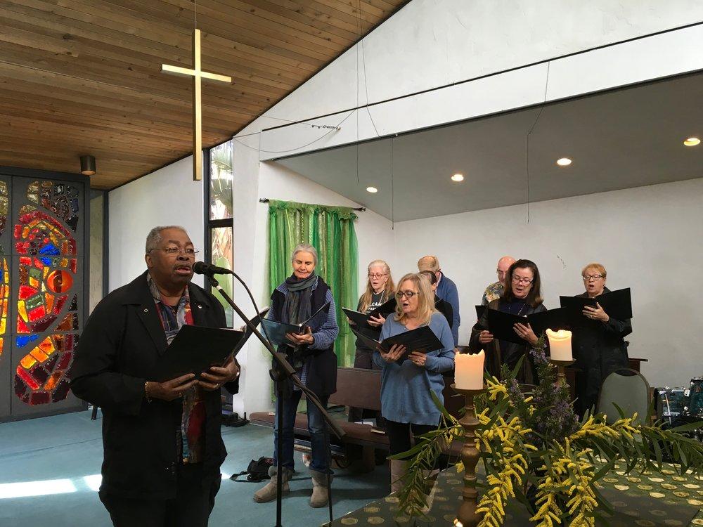 Melvin with choir BG singing.JPG