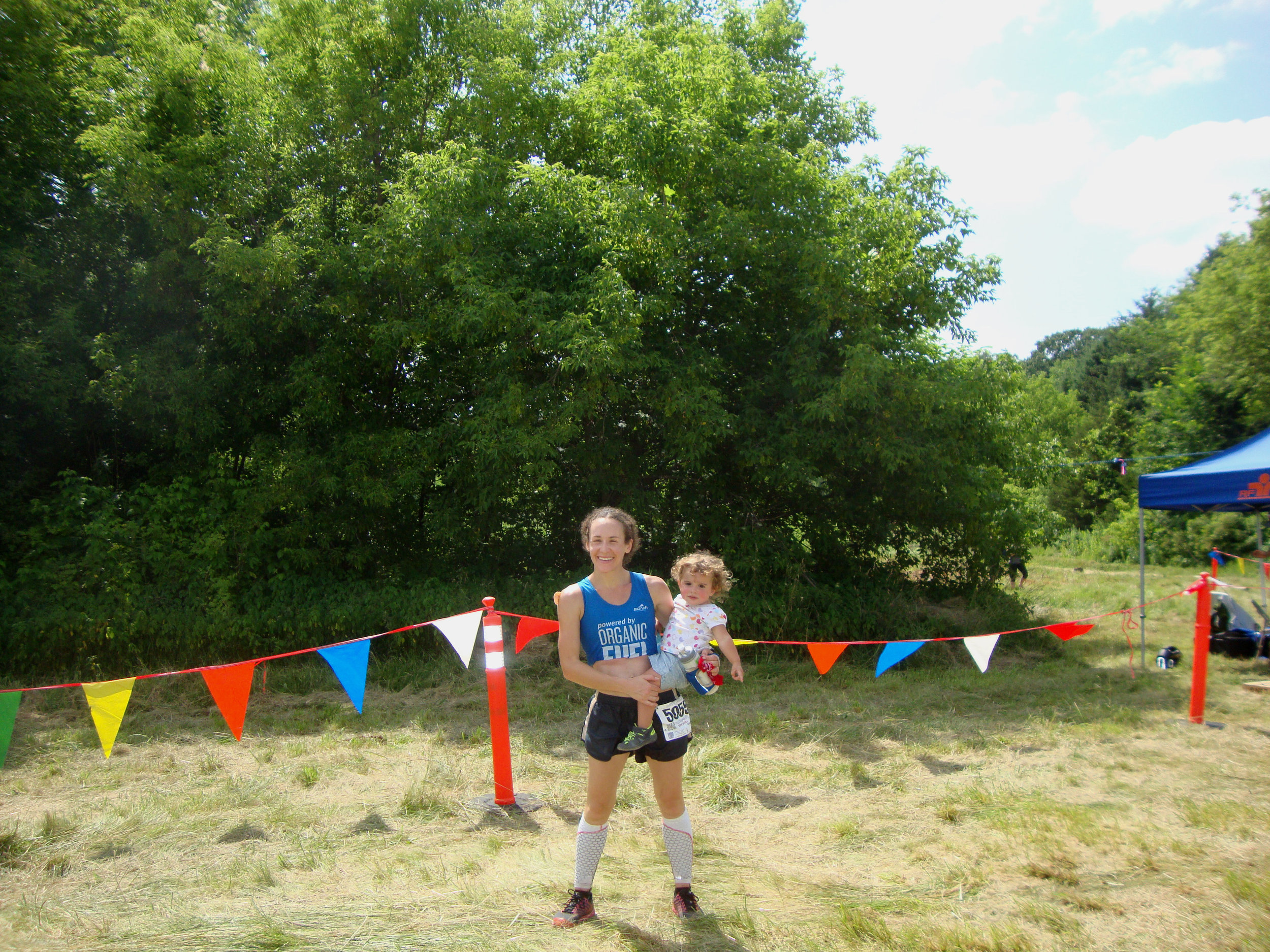 Just over the finish line with Mischa, my 1.5 year old.