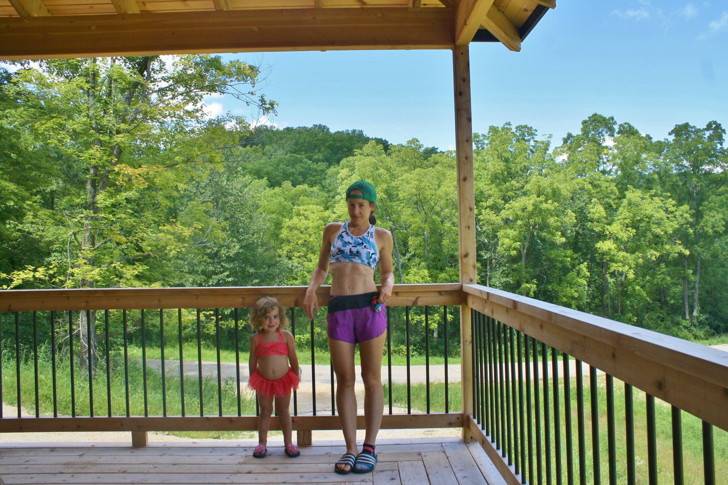 On the deck of our new house with Mischa. Now we live only a mile from Blue Mound State Park with has great trails!
