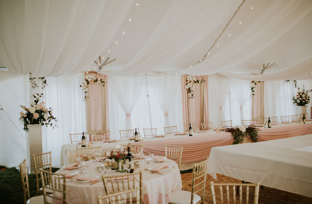 Romantic Wonderland - We transformed a white tent with lights, accents fabrics, amazing florals and soft pink palette.Photography: BRZ PhotographyView Gallery>