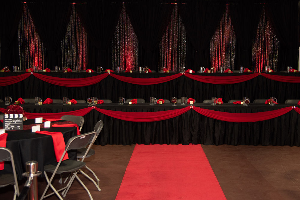 Hollywood Glam - The theme of Hollywood glam was staged with school colours of red & black. The graduation reception had everything from elegant Hollywood walkway, uplighting, & table decor to suit their style.View Gallery>Photography: One Shot Photography by Michelle Wurban