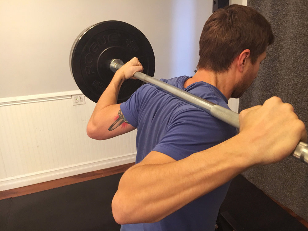 Bar Position: Across shoulders, not on the neck!