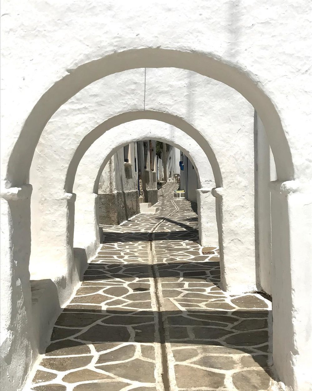 In cycladic architecture arches form covered areas in the public space.
