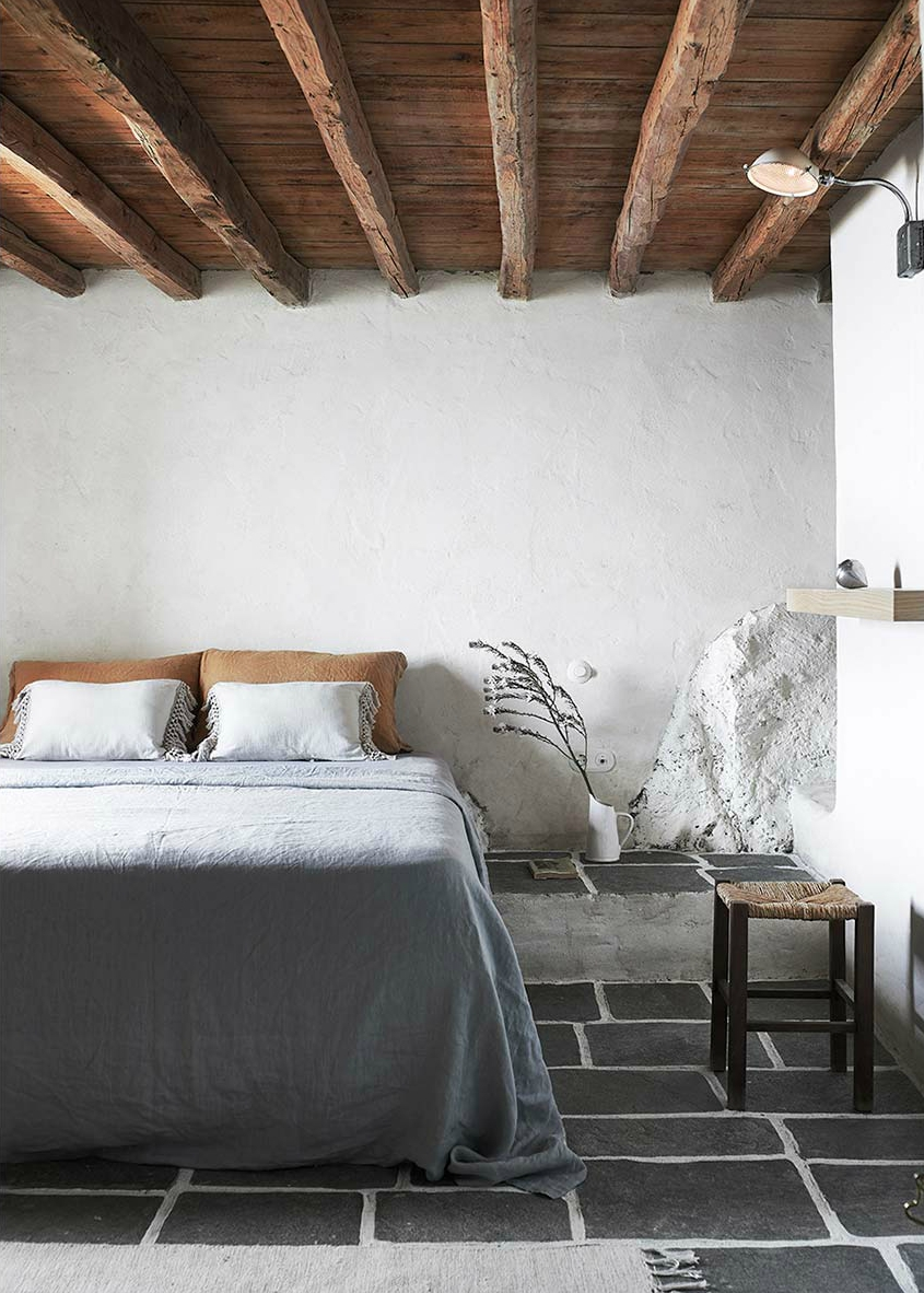 Stone slab floors and exposed beam ceilings are typical in cycladic architecture.