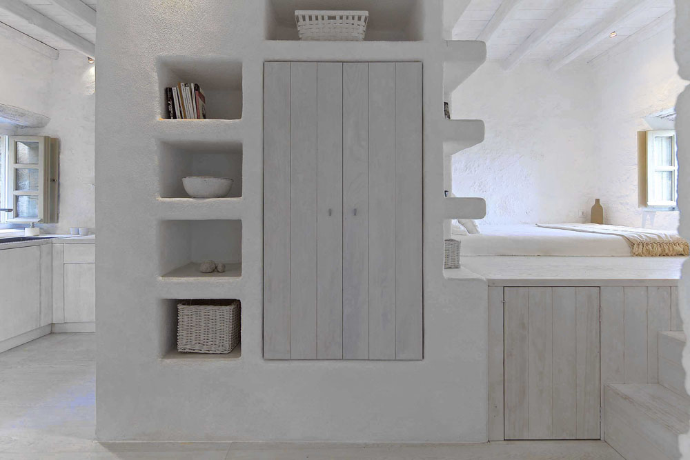 In cycladic houses built-in furniture creates clean, minimal interiors.