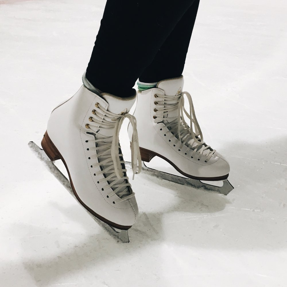 ice skates worn by student at a learn to skate lesson