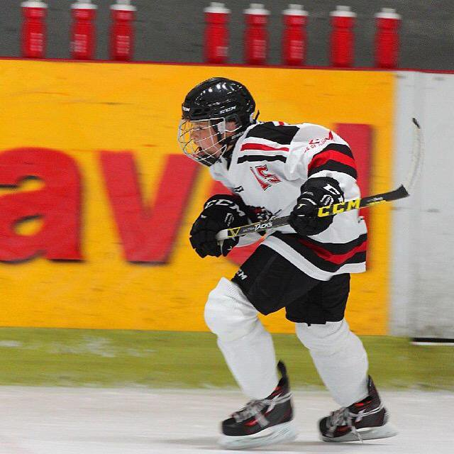 young ice hockey player skating fast
