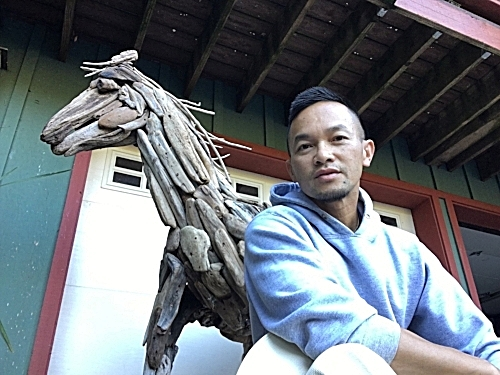 Minh with his first driftwood horse